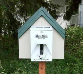 House shaped Mutt Mitt dispenser encouraging people to pick up pet waste