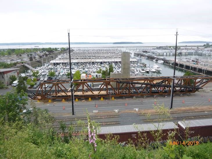 Looking west to the marina from Grand Avenue Park at the painted steel truss bridge span in West