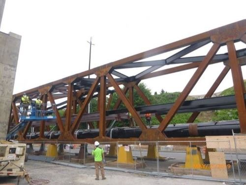 Painting of portions of the steel truss bridge span