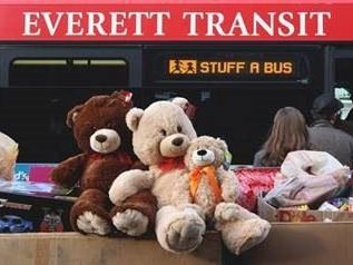 toy donations stacked in front of bus