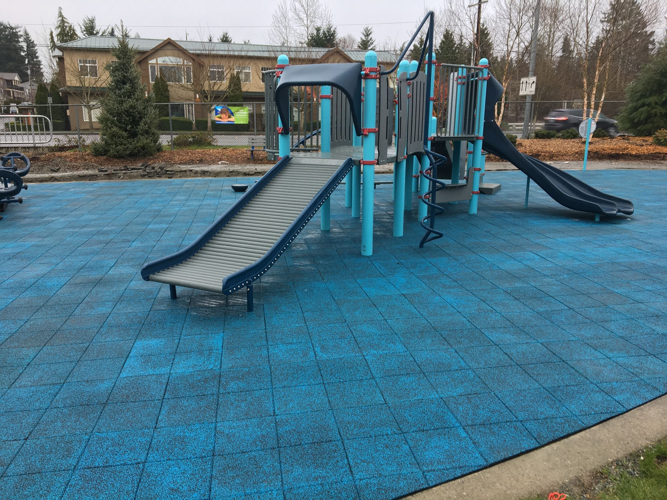 Blue playground tiles at Hauge Homestead Park