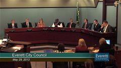 Everett City Council members seated at a public meeting May 29, 2013 as shown on the Everett Channel