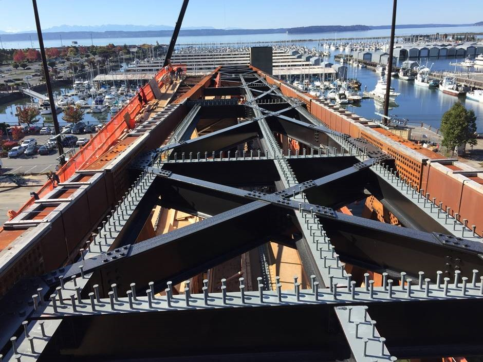 Welded shear studs line the top level of the steel truss bridge span prior to construction of forms.
