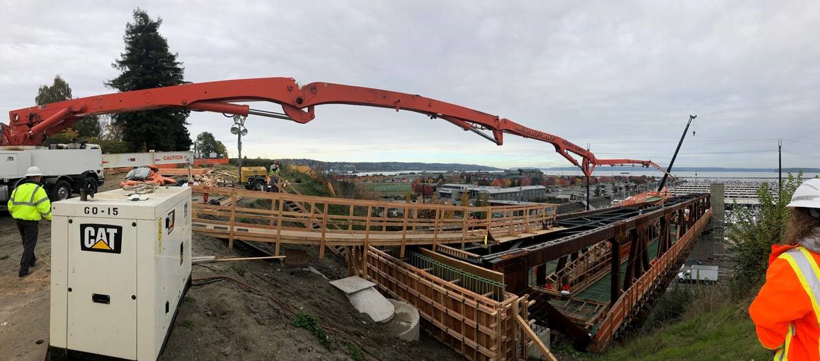 The long boom of the concrete pumper is seen stretching to the limit for the concrete pour.