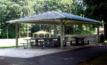 Park shelter with picnic tables underneath